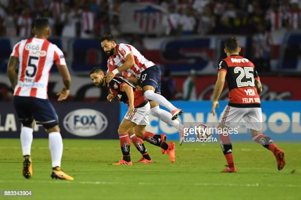 Colombia's Junior Uruguayan midfielder Henry Mier vies for the ball with Brazil's Flamengo midfielder Diego during the Copa Sudamericana semifinal...