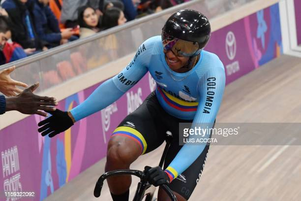 Colombia's Kevin Quintero celebrates after winning the Men's Sprint Bronze Final of the Track Cycling competition during the Lima 2019 Pan-American...