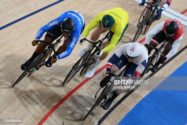 Colombia's Kevin Santiago Quintero Chavarro, Australia's Matthew Glaetzer and Britain's Jack Carlin compete in a heat of the men's track cycling...