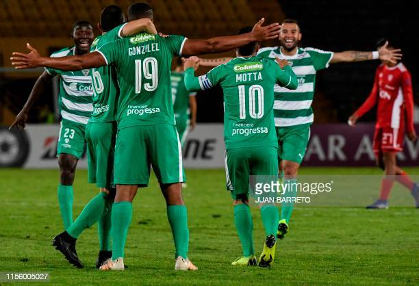 Colombia's La Equidad players celebrate after scoring against Bolivia's Royal Pari during a Copa Sudamericana football match at the El Campin...