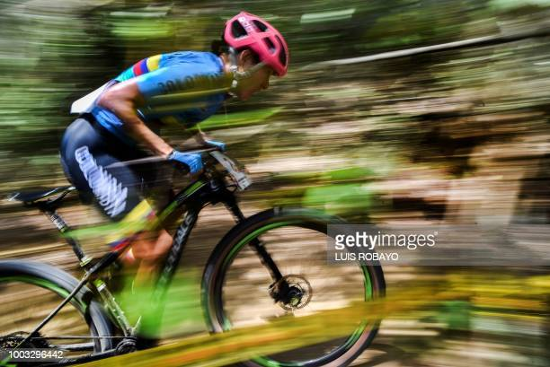 Colombia's Laura Abril competes in the Women's Mountain Bike Cross Country finals event of the cyclying competition of the 2018 Central American and...