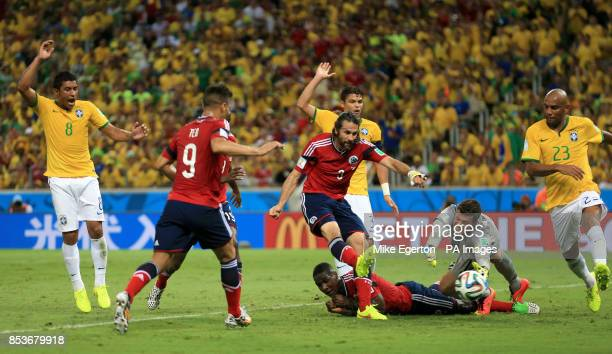 Colombia's Mario Yepes scores but the goal is disallowed for offside during the quarter final match at the Estadio Castelao Fortaleza