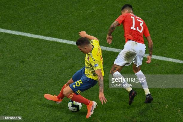 Colombia's Mateus Uribe and Chile's Erick Pulgar vie for the ball during their Copa America football tournament quarterfinal match at the Corinthians...