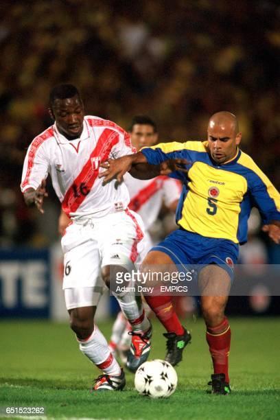 Colombia's Mauricio Serna battles with Peru's Andres Mendoza