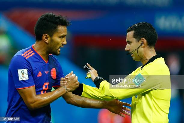 Colombia's midfielder Abel Aguilar argues with Mexican referee Cesar Ramos during the Russia 2018 World Cup Group H football match between Poland and...