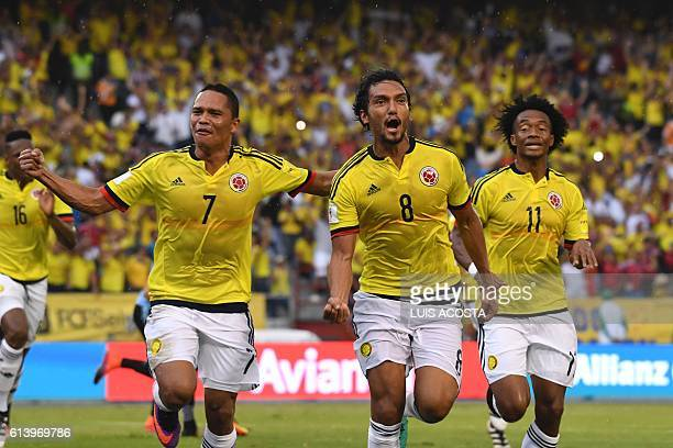 Colombia's midfielder Abel Aguilar celebrates with forward Carlos Bacca and midfielder Juan Cuadrado after scoring against Uruguay during their...