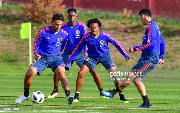 Colombia's midfielder Abel Aguilar Colombia's defender Yerry Mina Colombia's forward Juan Cuadrado and Colombia's midfielder James Rodriguez take...