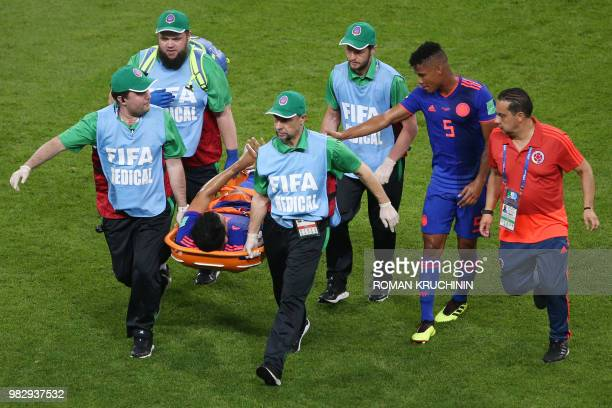 Colombia's midfielder Abel Aguilar is stretched out due to an injury during the Russia 2018 World Cup Group H football match between Poland and...