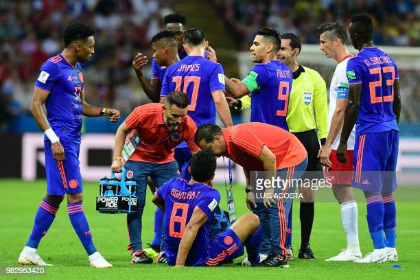 Colombia's midfielder Abel Aguilar is treated by medical staff during the Russia 2018 World Cup Group H football match between Poland and Colombia at...