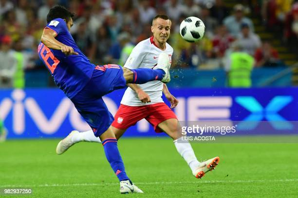 Colombia's midfielder Abel Aguilar kciks the ball past Poland's midfielder Jacek Goralski during the Russia 2018 World Cup Group H football match...