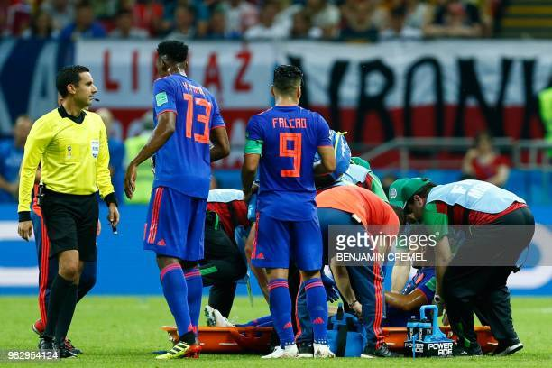Colombia's midfielder Abel Aguilar leaves the pitch on a stretcher during the Russia 2018 World Cup Group H football match between Poland and...