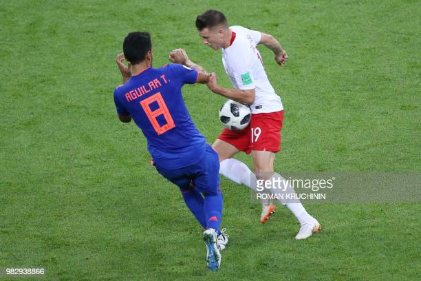 Colombia's midfielder Abel Aguilar vies with Poland's midfielder Piotr Zielinski during the Russia 2018 World Cup Group H football match between...