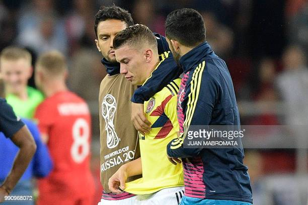 Colombia's midfielder Abel Aguilar walks with Colombia's midfielder Mateus Uribe after the penalty shootout at the end of the Russia 2018 World Cup...