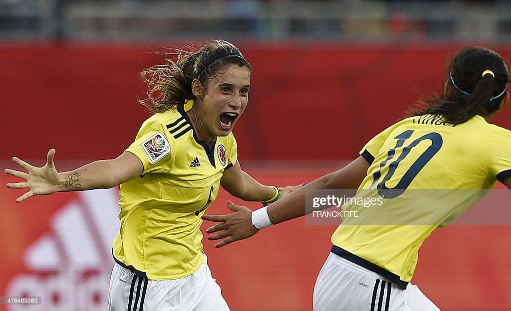 Colombia's midfielder Daniela Montoya (L) celebrates her goal during a Group F match at the 2015 FIFA Women's World Cup between Colombia and Mexico at Moncton Stadium in Moncton, Canada, on June 9, 2015.