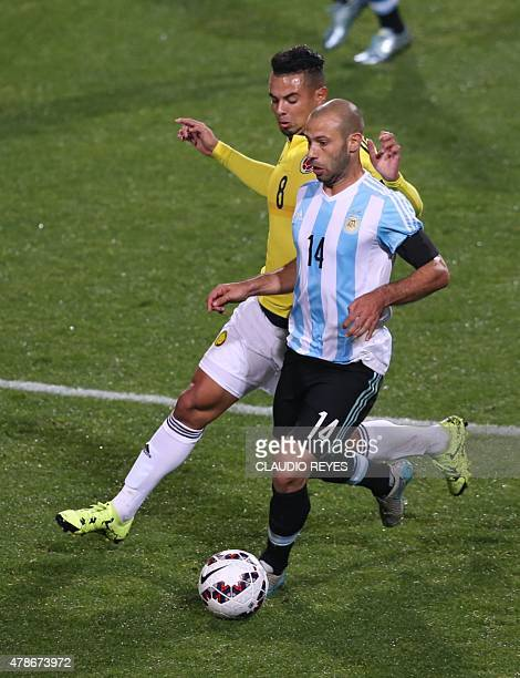 Colombia's midfielder Edwin Cardona vies for the ball with Argentina's midfielder Javier Mascherano during the 2015 Copa America football...