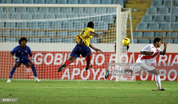 ffc3eb48d Colombia s midfielder Elkin Blanco shoots as Peru s goalkeeper Eder Hermoza  watches the ball during their U20