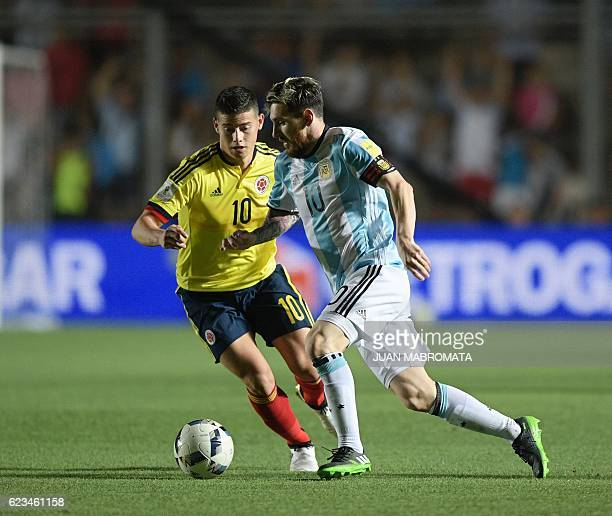 TOPSHOT Colombia's midfielder James Rodriguez and Argentina's Lionel Messi vie for the ball during their 2018 FIFA World Cup qualifier football match...