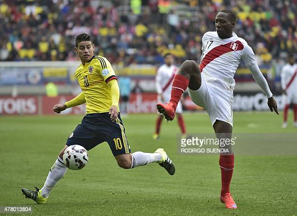 Colombia's midfielder James Rodriguez and Peru's defender Luis Advincula vie for the ball during their 2015 Copa America football championship match...