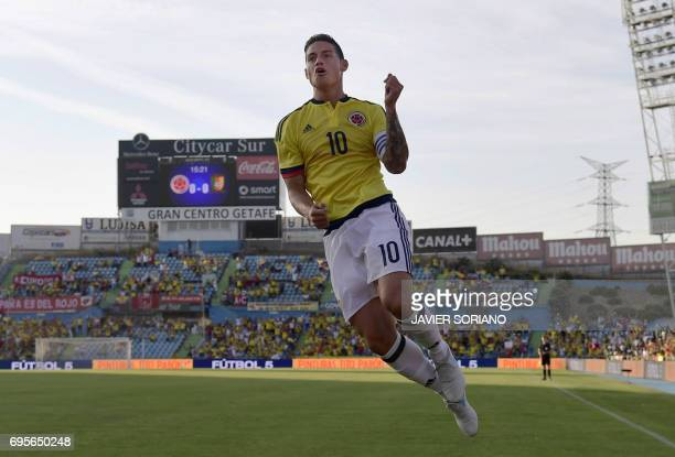 TOPSHOT Colombia's midfielder James Rodriguez celebrates a goal during the friendly football match Cameroon vs Colombia at the Col Alfonso Perez...