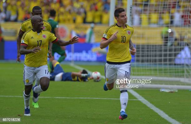 Colombia's midfielder James Rodriguez celebrates next to Colombia's defender Pablo Armero after scoring against Bolivia on penalty during their 2018...