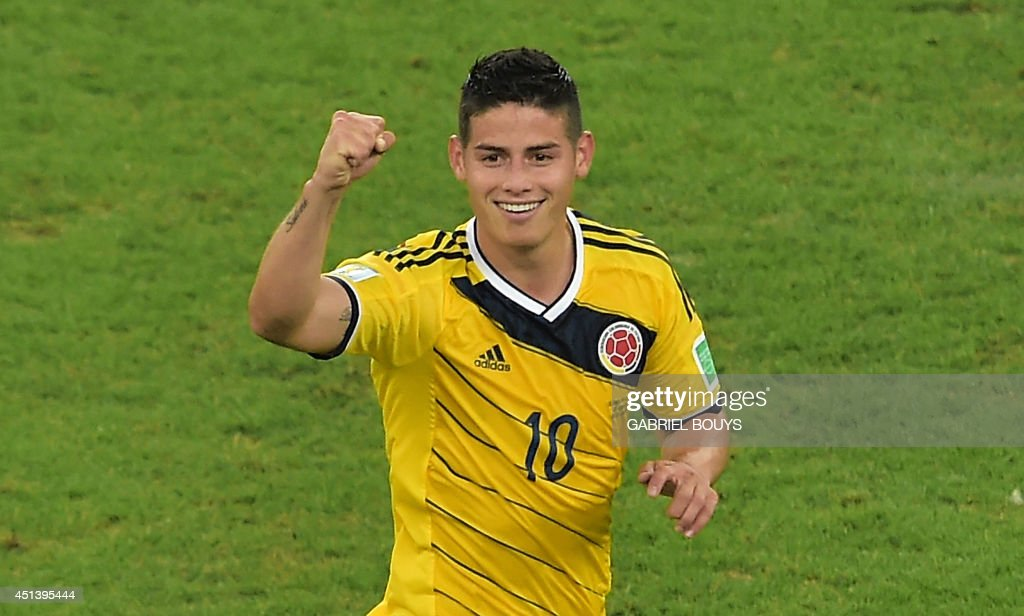 Colombia's midfielder James Rodriguez celebrates scoring the 2-0 goal during the Round of 16 football match between Colombia and Uruguay at the Maracana Stadium in Rio de Janeiro during the 2014 FIFA World Cup in Brazil on June 28, 2014. AFP PHOTO / GABRIEL BOUYS / AFP PHOTO / Gabriel BOUYS