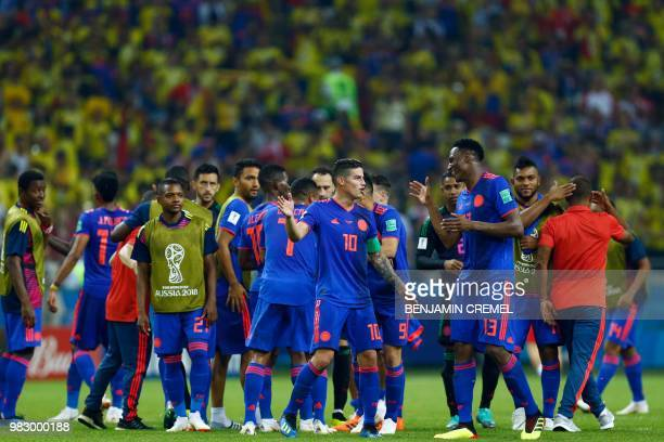Colombia's midfielder James Rodriguez celebrates with Colombia's defender Yerry Mina and teammates at the end of the Russia 2018 World Cup Group H...