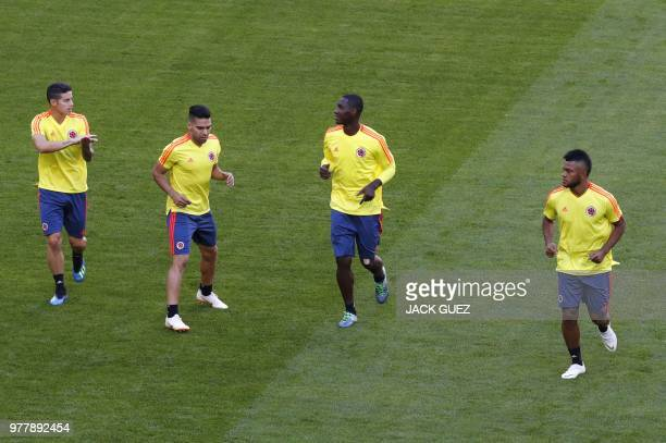 Colombia's midfielder James Rodriguez Colombia's forward Falcao and Colombia's defender Cristian Zapata take part in a training session on June 18...