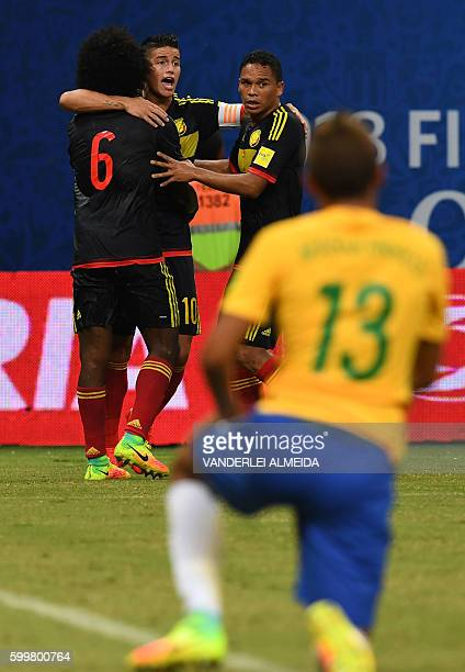 Colombia's midfielder James Rodriguez, Colombia's midfielder Carlos Sanchez and Colombia's forward Carlos Bacca react after an own goal by Brazil's...