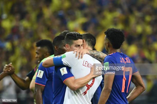 TOPSHOT Colombia's midfielder James Rodriguez hugs Poland's forward Robert Lewandowski at the end of the Russia 2018 World Cup Group H football match...