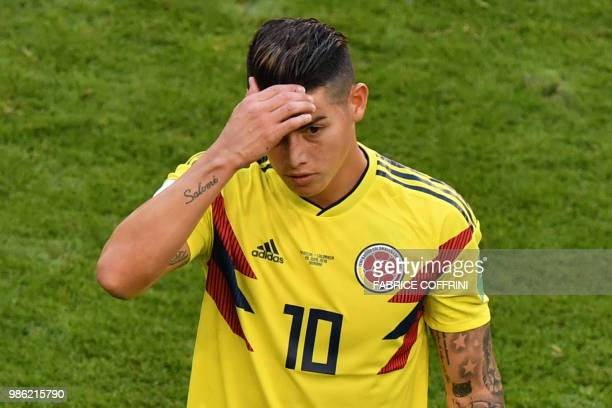 Colombia's midfielder James Rodriguez reacts as he leaves the football pitch due to an injury during the Russia 2018 World Cup Group H football match...