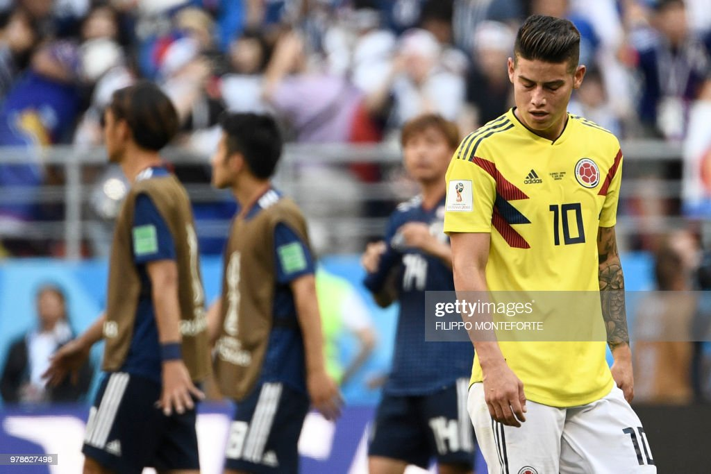 TOPSHOT - Colombia's midfielder James Rodriguez reacts at the end of the Russia 2018 World Cup Group H football match between Colombia and Japan at the Mordovia Arena in Saransk on June 19, 2018. (Photo by Filippo MONTEFORTE / AFP) / RESTRICTED