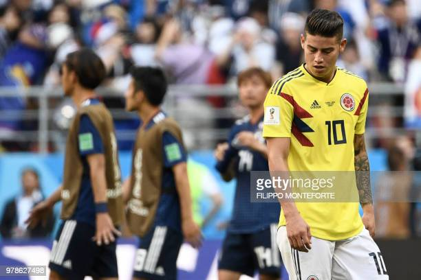 TOPSHOT Colombia's midfielder James Rodriguez reacts at the end of the Russia 2018 World Cup Group H football match between Colombia and Japan at the...
