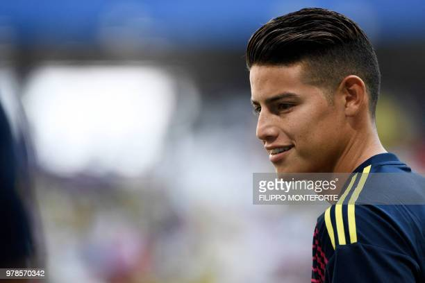 Colombia's midfielder James Rodriguez smiles as he warms up before the Russia 2018 World Cup Group H football match between Colombia and Japan at the...