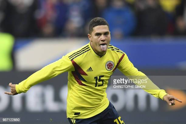 Colombia's midfielder Juan Fernando Quintero celebrates after scoring a goal during the friendly football match between France and Colombia at the...