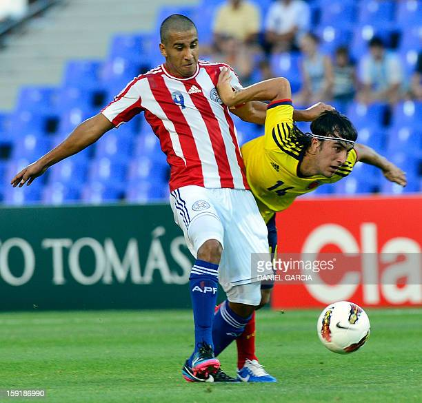 Colombia's midfielder Sebastian Perez vies for the ball with Paraguay's forward Cecilio Dominguez, during their South American U-20 Championship...