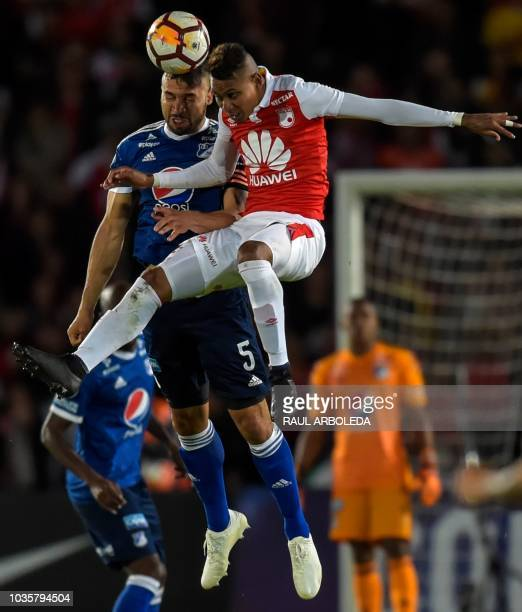 Colombia's Millonarios player Andres Cadavid and Colombia's Independiente Santa Fe Arley Rodriguez jump for the ball during their Copa Sudamericana...