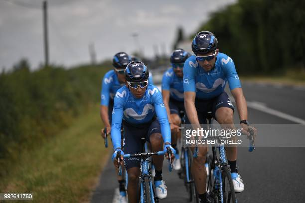 Colombia's Nairo Quintana and Spain's Imanol Erviti ride with their Spain's Movistar Team cycling team teammates during a training session on July 6...