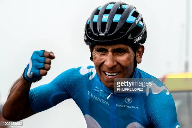 Colombia's Nairo Quintana celebrates as he crosses the finish line to win the 17th stage of the 105th edition of the Tour de France cycling race,...