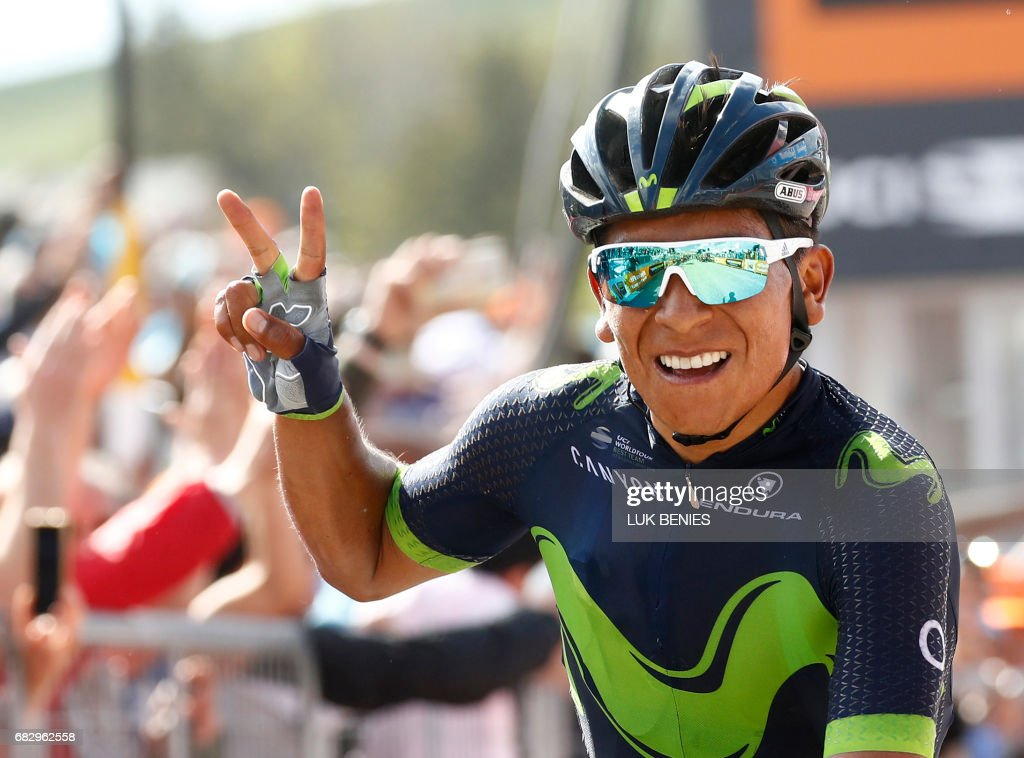 Colombia's Nairo Quintana of team Movistar celebrates as he crosses the finish line to win the 9th stage of the 100th Giro d'Italia, Tour of Italy, cycling race from Montenero di Bisaccia to Blockhaus on May 14, 2017. / AFP PHOTO / Luk BENIES