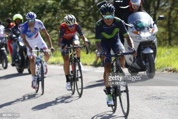 Colombia's Nairo Quintana of team Movistar climbs the Blockhaus with France's Thibaut Pinot of team FDJ and Italy's rider of team Bahrain Merida...