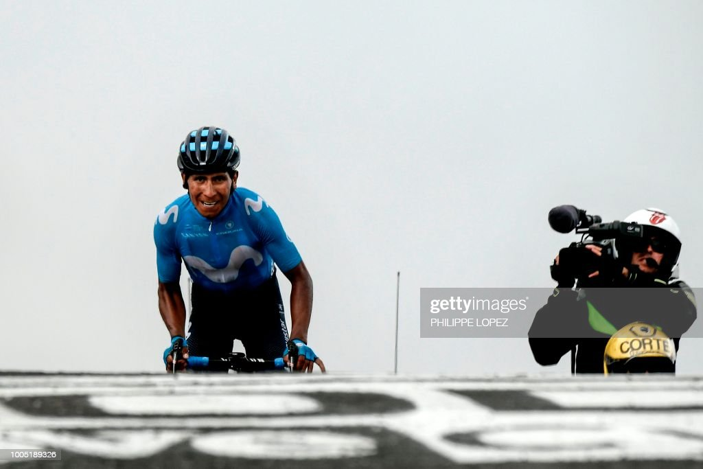 TOPSHOT - Colombia's Nairo Quintana rides ion the last meters to cross the finish line and win the 17th stage of the 105th edition of the Tour de France cycling race, between Bagneres-de-Luchon and Saint-Lary-Soulan Col du Portet, southwestern France, on July 25, 2018.