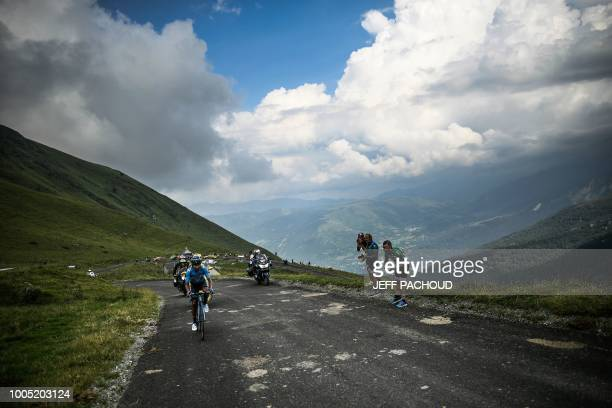 Colombia's Nairo Quintana rides up the Col du Portet pass on his way to win the 17th stage of the 105th edition of the Tour de France cycling race,...