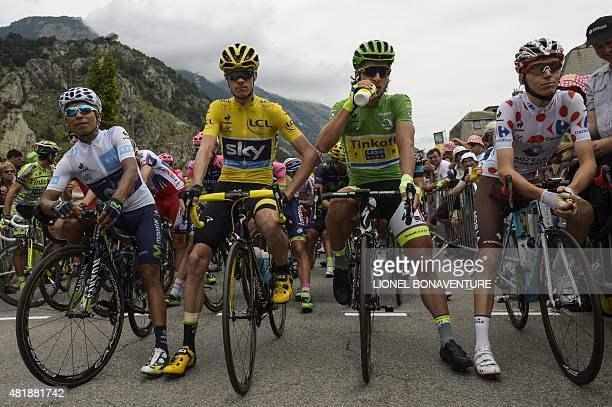 Colombia's Nairo Quintana, wearing the best young's white jersey, Great Britain's Christopher Froome, wearing the overall leader's yellow jersey,...