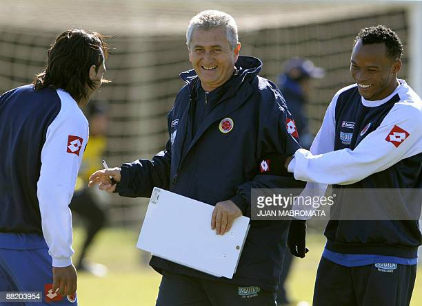 Colombia's national football team coach Eduardo Lara jockes with forward Radamel Falcao Garcia and defender Camilo Zuniga during a training session...