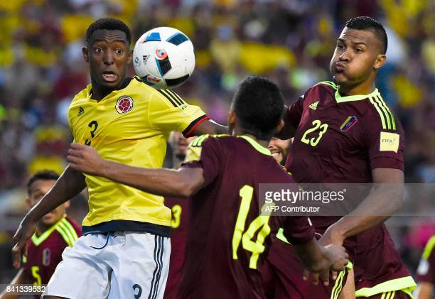 Colombia's Oscar Murillo Venezuela's Yangel Herrera and Venezuela's Salomon Rondon vie for the ball during their 2018 World Cup qualifier football...