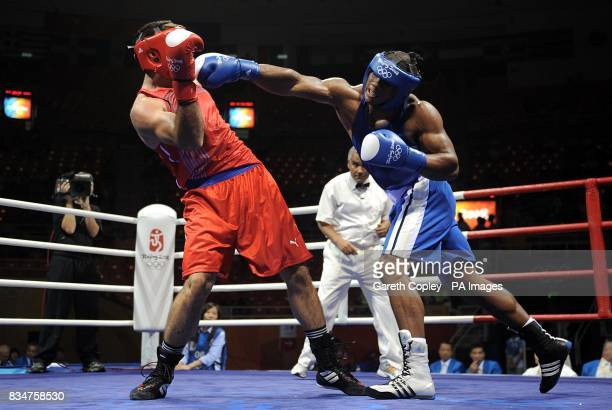 Colombia's Oscar Rivas in action against Kubrat Pulev during their first round super heavyweight bout at the Beijing Workers Gymnasium in Beijing...