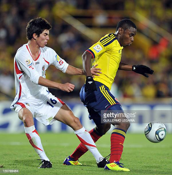 Colombia's player Duvan Zapata and Costa Rica's player Ariel Soto vie for the ball during their FIFA's Under20 World Cup Round of 16 football match...