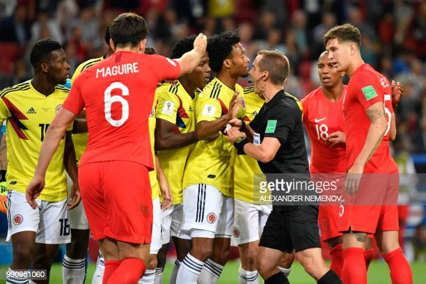 TOPSHOT Colombia's players argue with US referee Mark Geiger after he gave a penalty to England during the Russia 2018 World Cup round of 16 football...