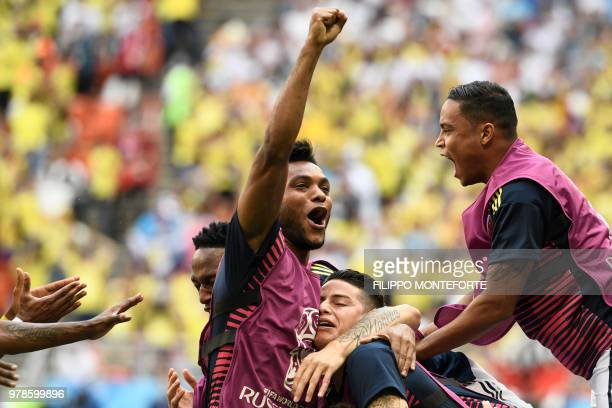 Colombia's players celebrate after scoring a goal during the Russia 2018 World Cup Group H football match between Colombia and Japan at the Mordovia...
