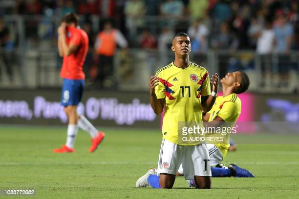 Colombia's players celebrate at the end of their South American U20 football match against Chile during their South American U20 football match at El...